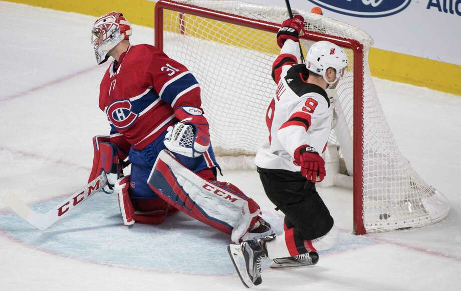 Montreal Canadiens goaltender Carey Price gives up a goal to New Jersey Devils' Taylor Hall during the third period of an NHL hockey game in Montreal, Sunday, April 1, 2018. (Graham Hughes/The Canadian Press via AP) Photo: Graham Hughes / The Canadian Press