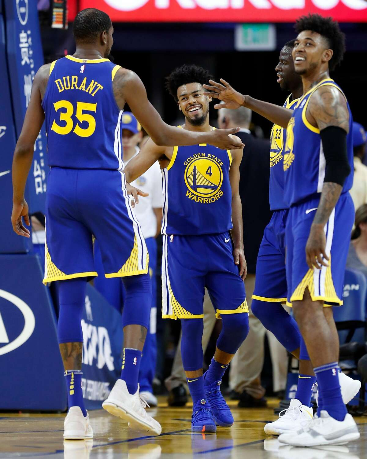 Golden State Warriors' Quinn Cook, Kevin Durant, Draymond Green and Nick Young enjoy themselves in 4th quarter of Warriors' 117-107 win over Phoenix Suns during NBA game at Oracle Arena in Oakland, Calif., on Sunday, April 1, 2018.