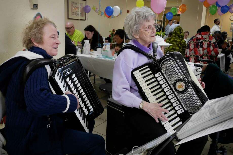 Peggy Hart, left, of Delmar, and Norma Colasessano of Troy play music for those attending the Easter dinner at the Capital City Rescue Mission on Sunday, April 1, 2018, in Albany, N.Y. The two women have been performing at the Easter dinner for over 5 years.  (Paul Buckowski/Times Union) / (Paul Buckowski/Times Union)