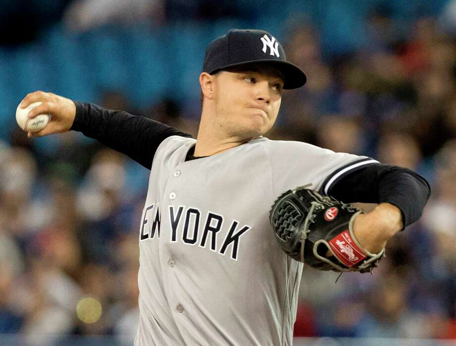 New York Yankees starting pitcher Sonny Gray throws against the Toronto Blue Jays during the first inning of their American League MLB baseball game in Toronto on Sunday April 1, 2018. (Fred Thornhill/The Canadian Press via AP) Photo: Fred Thornhill / The Canadian Press