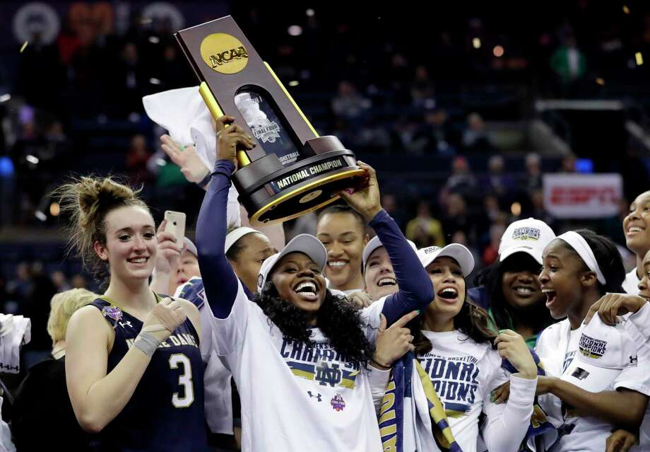 Notre Dame's Arike Ogunbowale holds the trophy after defeating Mississippi State in the final of the women's NCAA Final Four college basketball tournament, Sunday, April 1, 2018, in Columbus, Ohio. Notre Dame won 61-58. (AP Photo/Tony Dejak) Photo: Tony Dejak / Copyright 2018 The Associated Press. All rights reserved.