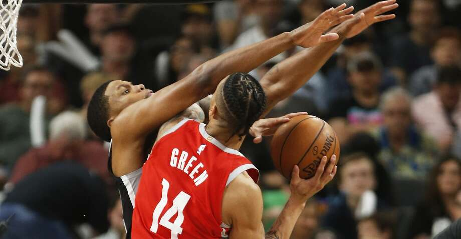 SAN ANTONIO,TX - APRIL 1 : Rudy Gay #22 of the San Antonio Spurs tries to stop Gerald Green #14 of the Houston Rockets at AT&T Center on April 1 , 2018 in San Antonio, Texas. NOTE TO USER: User expressly acknowledges and agrees that , by downloading and or using this photograph, User is consenting to the terms and conditions of the Getty Images License Agreement. (Photo by Ronald Cortes/Getty Images) Photo: Ronald Cortes/Getty Images