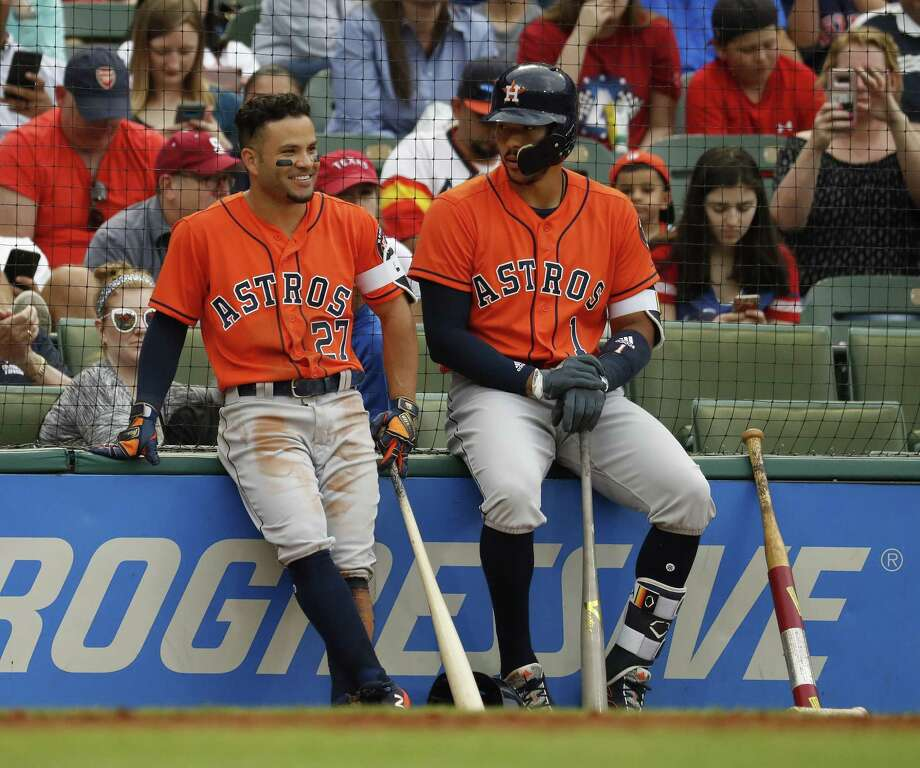 PHOTOS: The Astros prepare for a World Series repeat in 2018Houston Astros Jose Altuve (27) and Carlos Correa (1) wait during a pitching change in the fifth inning of an MLB baseball game at Globe Life Park, Sunday, April 1, 2018, in Arlington.See the best #NeverSettle tweets from the season so far... Photo: Karen Warren, Staff / Houston Chronicle / © 2018 Houston Chronicle