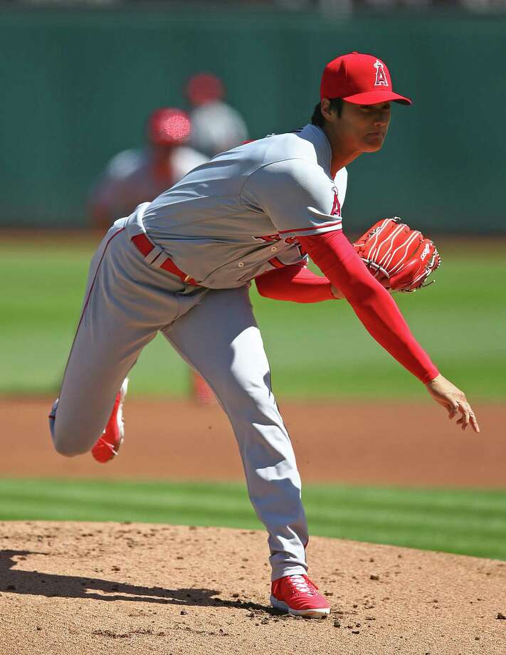 Los Angeles Angels' Shohei Ohtani works against the Oakland Athletics during the first inning of a baseball game on Sunday, April 1, 2018 in Oakland, Calif. (AP Photo/Ben Margot) Photo: Ben Margot / Copyright 2018 The Associated Press. All rights reserved.
