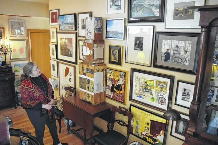 Allona Beasley Mitchell looks at some of her artwork that is on display in her new art studio at 602 E. State St., next to Lonzerotti's Italia Restaurant.