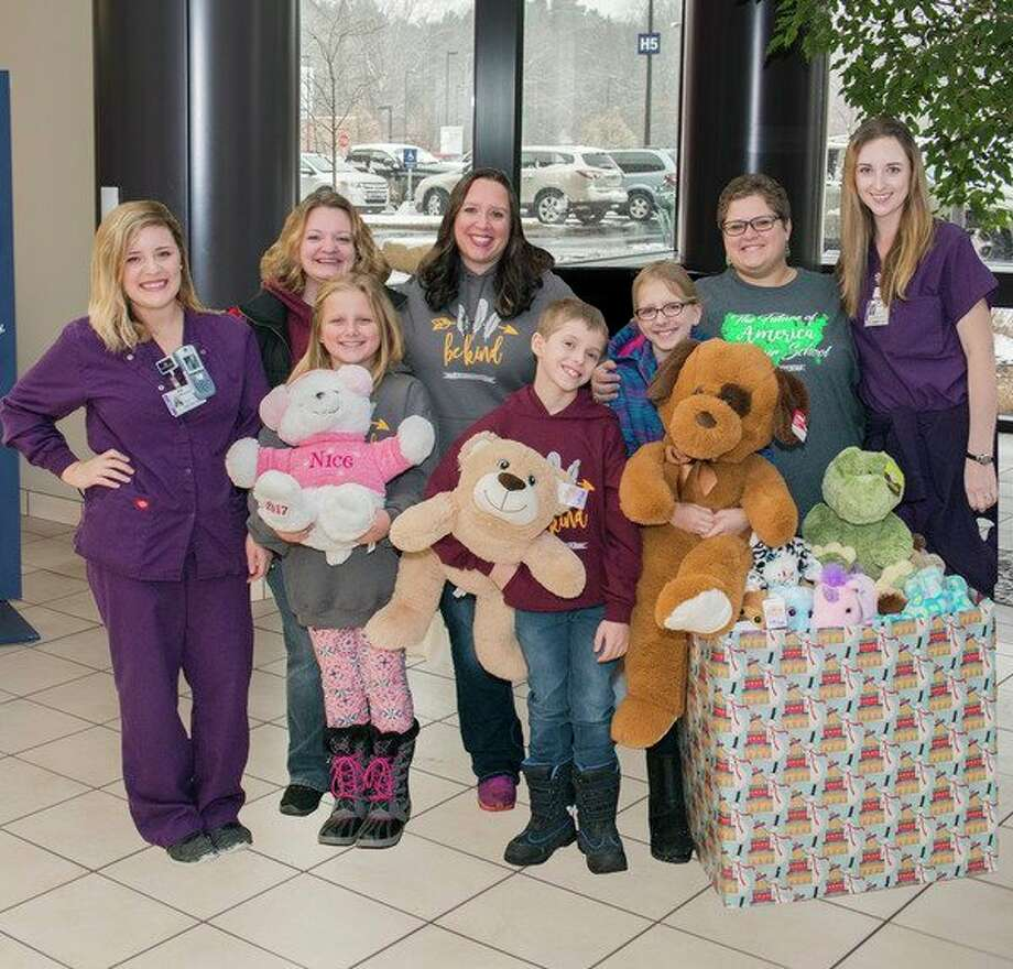 Children from Auburn Elementary along with their PTO coordinators delivered numerous new stuffed animals for young patients at MidMichigan Medical Center - Midland. From back left are Mallory Frisch, R.N., Amanda VanTol, Ashley Nowak, Elizabeth Garchow and Kendra Livesay, R.N. Helping to deliver some of the donated stuffed animals are students Alana Nowak, Evan Garchow and Veronica Nowak. (Photo provided)