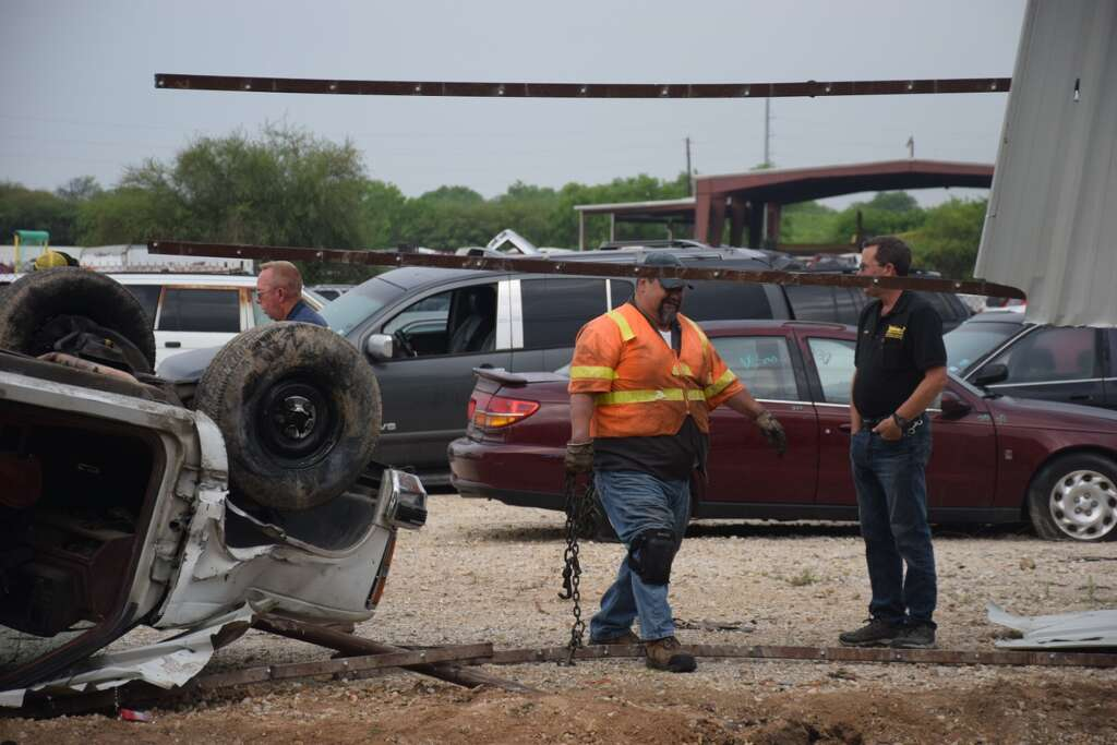 Woman hospitalized after rolling pickup into South Side car lot ...