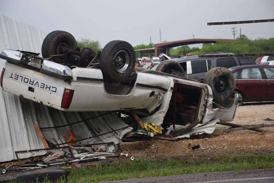 A woman driving a pickup truck lost control and rolled over into a Pick-N-Pull in the 11700 block of Applewhite Road on Monday, April 2, 2018. Photo: Caleb Downs / San Antonio Express-News
