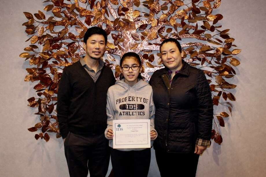 Independent Day School seventh grader Tenzin Tara, shown here with her parents Sherab Gyaltsen and Tsering Yangzom. Photo: Contributed Photo