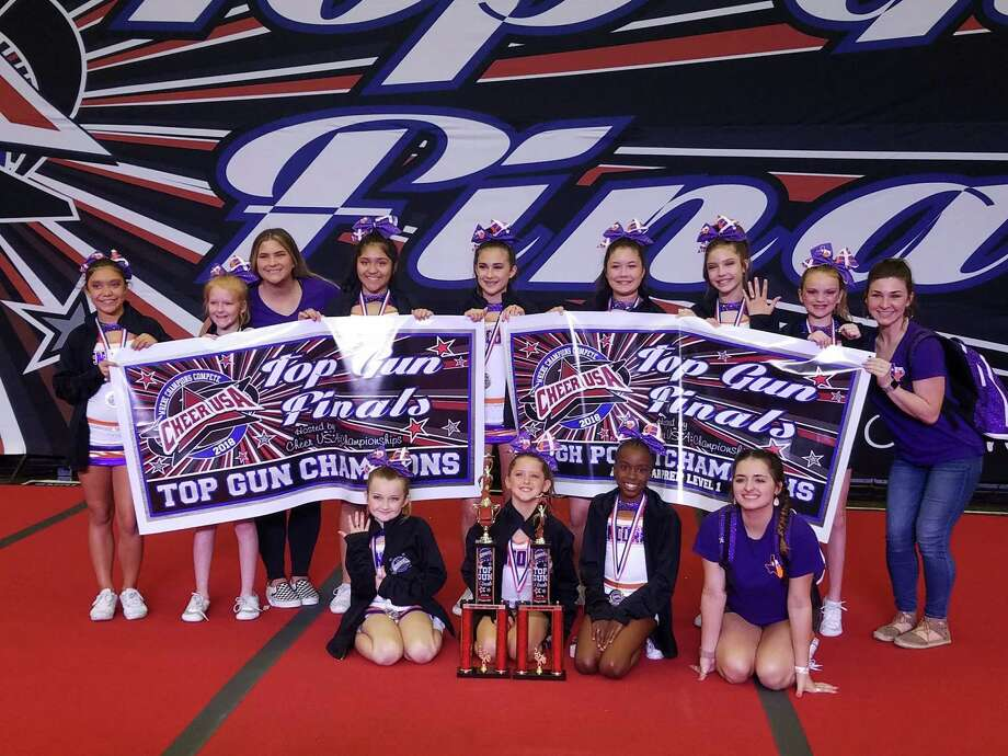 Encore EliteAll-Star Cheer and Tumbling gym in Humble's junior prep team poses after their wins at the Top Gun Championship on March 25. Photo: Courtesy Of Kris Williams