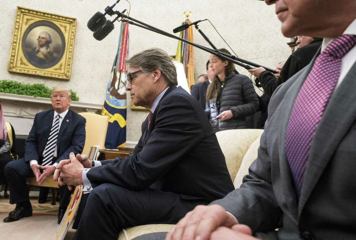 Rick Perry, U.S. secretary of energy, center, listens during a meeting with U.S. President Donald Trump, left, and Mohammed bin Salman, Saudi Arabia's crown prince, not pictured, in the Oval Office of the White House in Washington, D.C., U.S., on Tuesday, March 20, 2018. The U.S. and Saudi Arabia are developing an increasingly close partnership, encompassing everything from isolating Iran to bolstering business ties beyond energy into technology, defense and entertainment. Photographer: Kevin Dietsch/Pool via Bloomberg