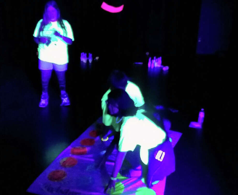 Students play glow-in-the-dark twister at a previous year's Project Graduation event at Kingwood Park High School. Photo: Courtesy OfMeg McKillop, Project Graduation Co-director
