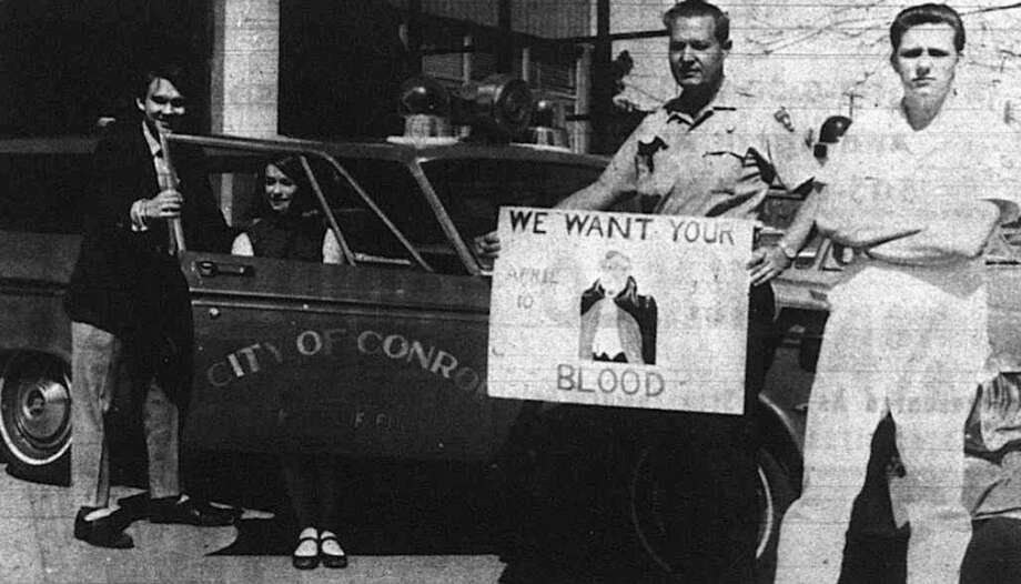 Pictured in April 1969 are Bill Cochran, left, president of the senior class of 1969 with Linda Caywood, in the car, secretary of the senior class of 1969 promoting the 1969 Senior Blood Drive with Glenn Gindrup, holding sign, the assistant chief of the Conroe Volunteer Fire Department and Jerry Gates, captain of the station. The 1969 collected 300 units for the first time in the history of the event which started in 1961.