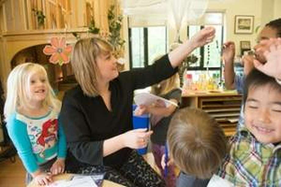 SIUE student Libby Linhares works with a class at the Early Childhood Center. Photo: For The Telegraph