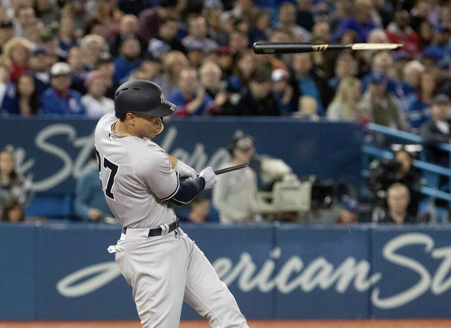 New York Yankees' Giancarlo Stanton shatters his bat in the sixth inning of a baseball game against the Toronto Blue Jays in Toronto, Friday, March 30, 2018. (Fred Thornhill/The Canadian Press via AP) Photo: Fred Thornhill, SUB / Associated Press / The Canadian Press