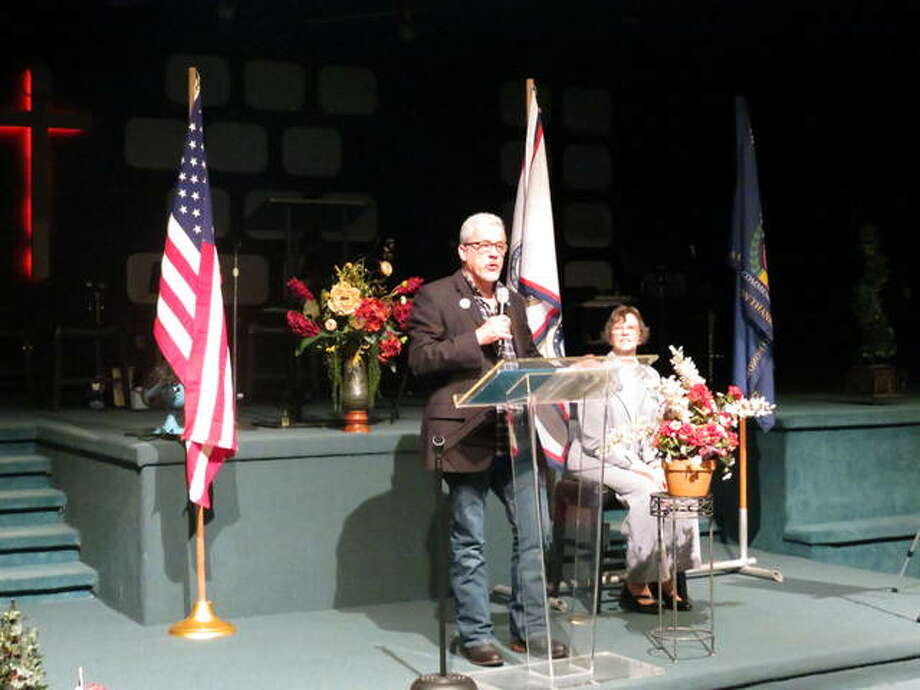 Pontoon Beach mayor Mike Pagano presents a proclamation recognizing Vietnam War veterans. Photo: For The Telegraph