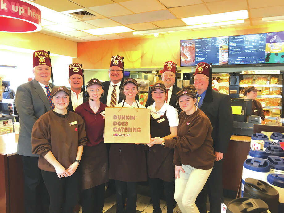 The Troy/Edwardsville Shrine Club would like to thank Troy Dunkin Donuts for donating two dozen donuts for the Shriners Free Screening Clinic March 3 at Anderson Hospital. In back from left are: Wayne Miles, James Alvarez, Jay Keeven (chairman of the event), George Bruner and Brian Brown. In front are Dunkin Donuts employees. Photo: For The Intelligencer