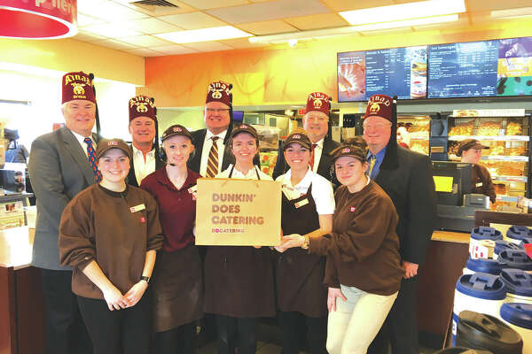 The Troy/Edwardsville Shrine Club would like to thank Troy Dunkin Donuts for donating two dozen donuts for the Shriners Free Screening Clinic March 3 at Anderson Hospital. In back from left are: Wayne Miles, James Alvarez, Jay Keeven (chairman of the event), George Bruner and Brian Brown. In front are Dunkin Donuts employees.