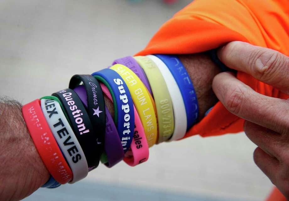 Richard Martinez wears wristbands in memory of gunshot victims during a march against gun violence across the Golden Gate Bridge in San Francisco last year. Photo: Paul Chinn, The Chronicle / ONLINE_YES