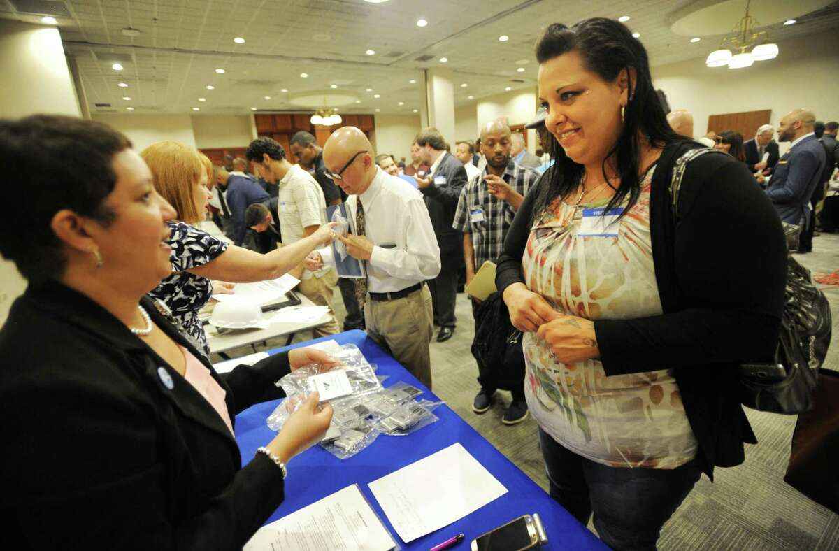 April DeVincentis, right, of Bridgeport, talks with Bridgeport Hospital representative Maria Alicea at the Bridgeport Re-Entry Career Fair, at the Margaret Morton Government Center in Bridgeport, Conn., on June 28, 2017.