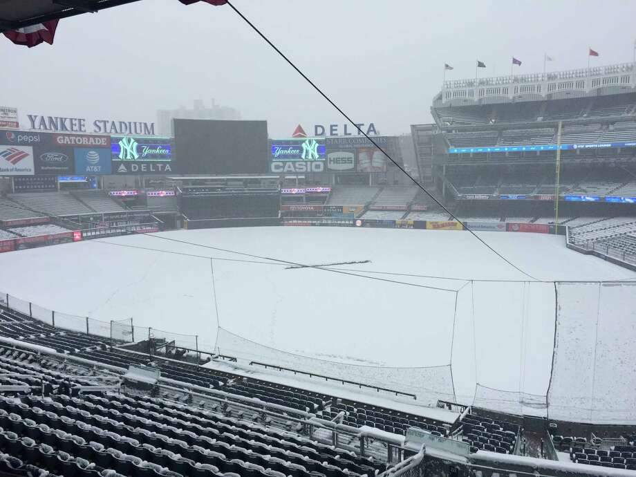 The Yankees returned home from Toronto only to have their home opener against the Tampa Bay Rays snowed out on Monday, April 2, 2018, as an overnight storm dumped heavy, wet snow on the New York metropolitan area. Photo: Leif Skodnick/Times Union