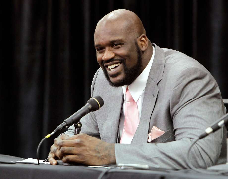 Shaquille O'Neal announces his retirement from NBA basketball at his home in Florida in 2011. Now a minority owner of the Sacramento Kings, O'Neal is becoming the general manager of the team's new video-game affiliate. Photo: John Raoux / Associated Press 2011