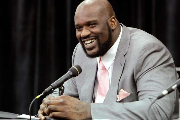 FILE - This June 3, 2011, file photo shows Shaquille O'Neal announcing his retirement from NBA basketball at his home in Windermere, Fla. O'Neal has agreed to a multiyear deal with Turner Sports to become an analyst on its NBA coverage. O'Neal, who retired last month, will join TNT's studio show with Charles Barkley, Kenny Smith and Ernie Johnson. He also will contribute to NBA TV and NBA.com. The agreement announced Thursday, July 14, 2011, includes a development deal with Turner's entertainment and animation networks.
