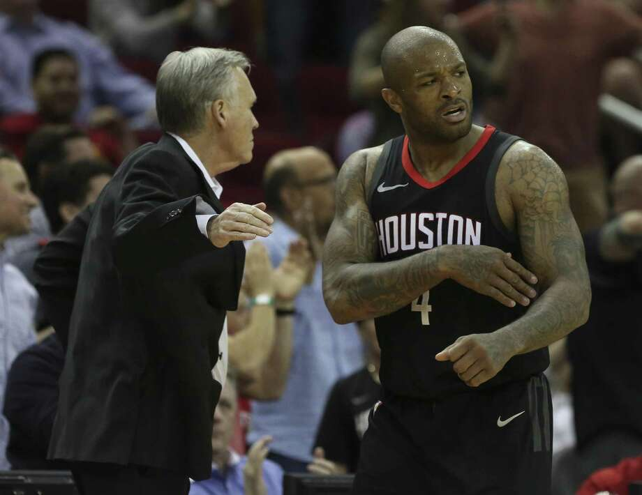 Houston Rockets forward PJ Tucker (4) high-fives head coach Mike D'Antoni to cheer for himself successfully defensing Phoenix Suns guard Troy Daniels (30) during the fourth quarter of the NBA game at Toyota Center on Friday, March 30, 2018, in Houston. The Houston Rockets defeated the Phoenix Suns 104-103 the last second of the game.( Yi-Chin Lee / Houston Chronicle ) Photo: Yi-Chin Lee / Houston Chronicle / © 2018 Houston Chronicle