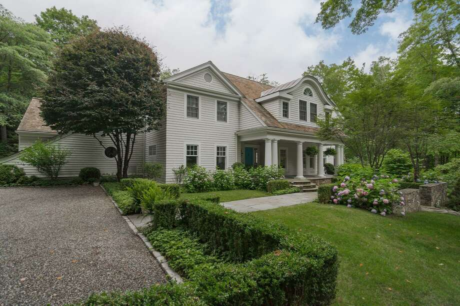 The 13-room colonial house at 279 Rosebrook Road sits on a 2.31-acre level and gently sloping property surrounded by private land owned by the New Canaan Audubon Society.
