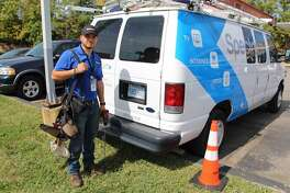 A Spectrum worker in Kansas. The cable TV service is owned by Charter Communications in Stamford, Conn.