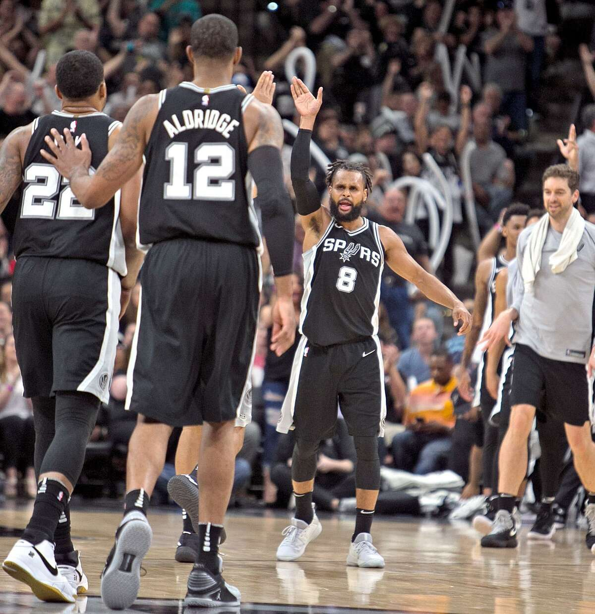 SAN ANTONIO,TX - APRIL 1 : Patty Mills #8 of the San Antonio Spurs celebrats with teammates after hitting a three at AT&T Center on April 1 , 2018 in San Antonio, Texas. NOTE TO USER: User expressly acknowledges and agrees that , by downloading and or using this photograph, User is consenting to the terms and conditions of the Getty Images License Agreement. (Photo by Ronald Cortes/Getty Images)