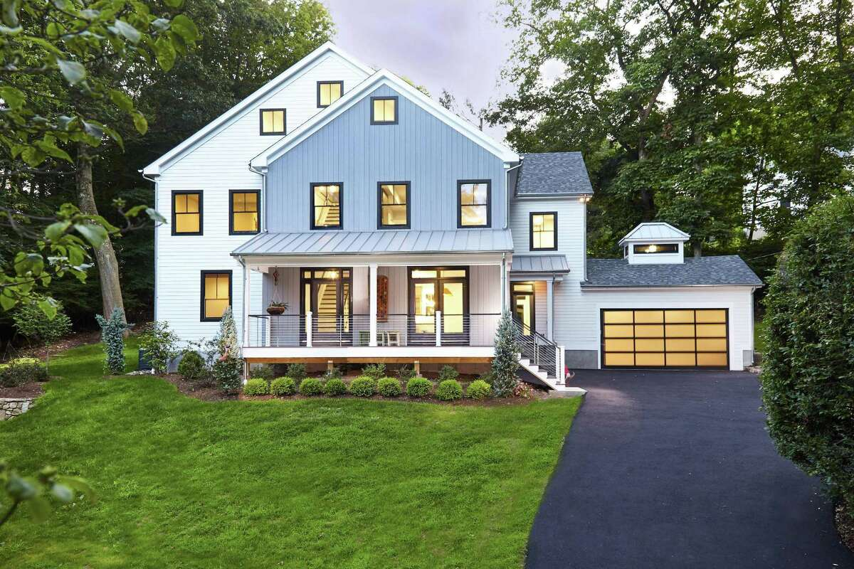 The modern industrial colonial farmhouse at 5 Ridgewood Lane was built in 2011 with reclaimed and re-purposed materials.