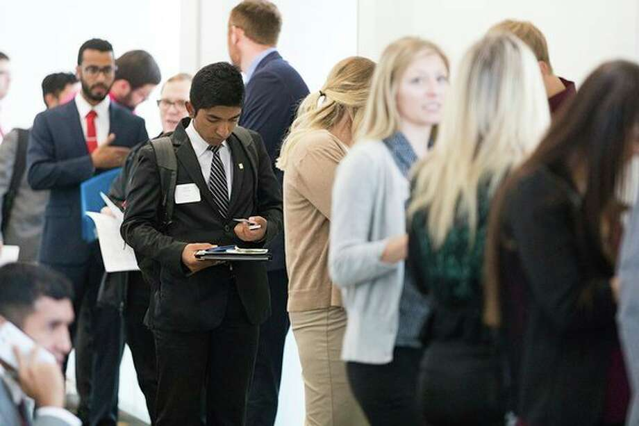 Prospective employees wait in line during an employment fair at Saginaw Valley State University in October 2017. (Photo provided)