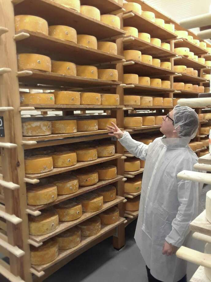 Arethusa's cheesemaker Matt Benham leads a tour inside one of the dairy's cheese caves, a chilled room where the prize-winning blue cheese ripens before it's ready to be sold. Photo: Emily M. Olson / Hearst Connecticut Media