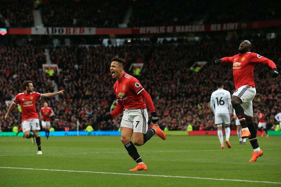 Manchester United's Alexis Sanchez celebrates scoring the team's second goal during Sunday's English Premier League game against Swansea at Old Trafford in Manchester. Photo: Lindsey Parnaby / Getty Images