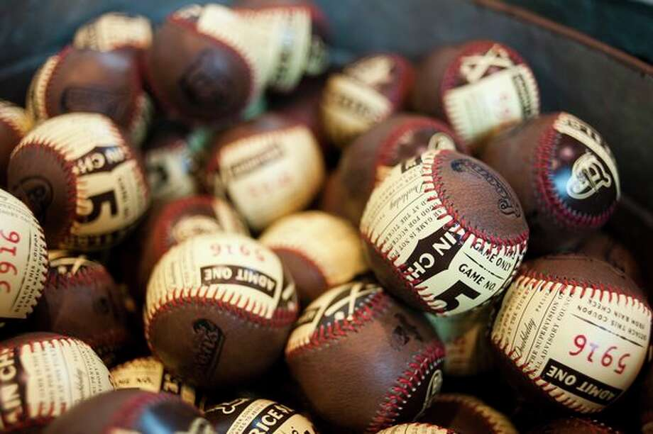 Old-fashioned baseballs will be sold in the Loon Loft's new retro gear section. (Katy Kildee/kkildee@mdn.net)