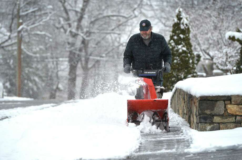 Milt Buchta clears the sidewalks of his neighbors houses on Norvel Rd. of snow during an April snowstorm that left 6 inches of snow in Norwalk Conn. on Monday April 2, 2018 Photo: Alex Von Kleydorff / Hearst Connecticut Media / Norwalk Hour