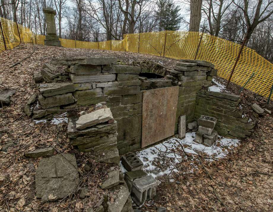 The Slingerland family burial vault at the rear of the former Mangia restaurant  Monday  Apr. 2, 2018 in Slingerlands, N.Y. The town and a committee of volunteers has started to clean up the site after decades of disrepair. (Skip Dickstein/Times Union) Photo: SKIP DICKSTEIN, Albany Times Union / 40043390A