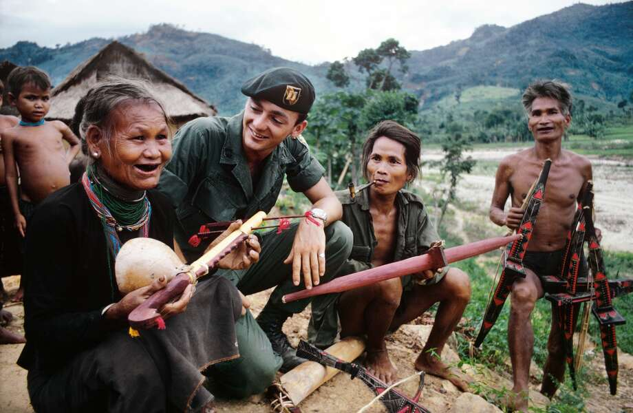 A member of the U.S. 101st Airborne Division visits with villagers of the Montagnards tribe in the Central Highlands of Vietnam, in 1969.See more photos from the Vietnam War ... Photo: Terry Fincher/Getty Images