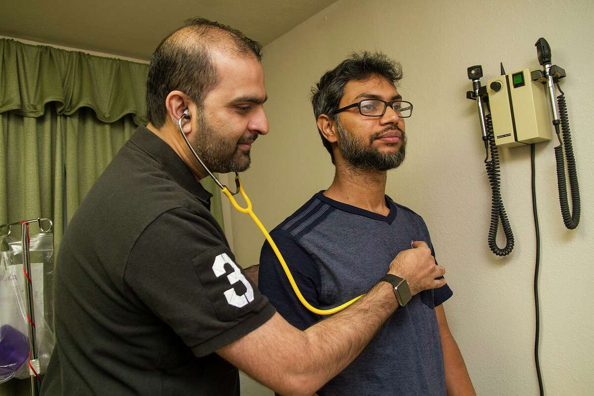 New numbers released Tuesday by the U.S. Census Bureau show more people are going without health insurance across the country and in Texas. Dr. Shahid Aziz, an endocrinologist, examined patient Mohammad Nasar at El Bari Clinic last year. The clinic provides free medical care to uninsured patients.