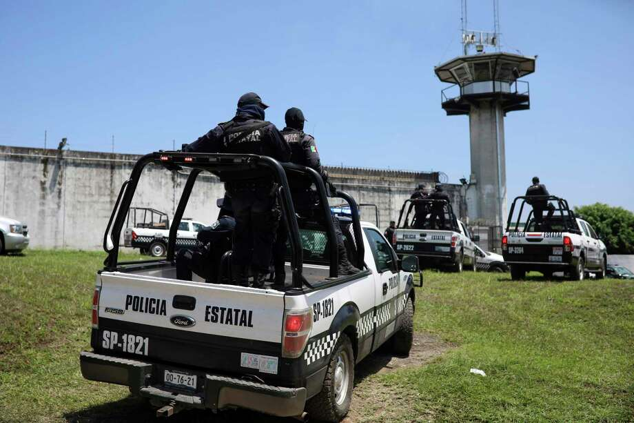 File photo: Mexican state police patrol outside La Toma prison in Veracruz in 2018. (AP Photo/Felix Marquez) Photo: Felix Marquez, Associated Press / Copyright 2018 The Associated Press. All rights reserved.