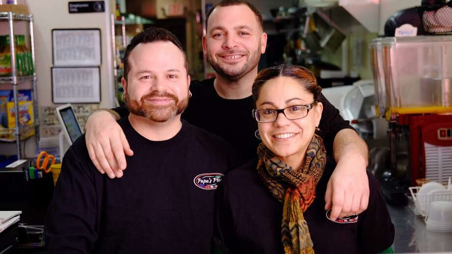 Ramon Perez III, Melvin Gonzalez and Christina Gonzalez, co-owners of Papa's Place. Photo: Contributed Photo / Connecticut Post Contributed