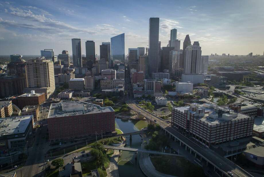 White Oak Bayou joins Buffalo Bayou at Allen's Landing between the University of Houston Downtown (right) and the Harris County Jail (left). Photo: Mark Mulligan, Houston Chronicle / Houston Chronicle / © 2018 Houston Chronicle