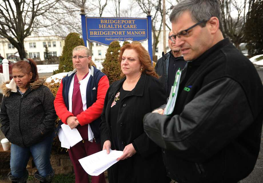 From left; Bridgeport Health Care Center employees Aida Marcano, of Stratford, Teresa Ortiz, of Naugatuck, President of AFSCME Local 1522 Sherrie Weller, and AFSCME Council 4 Public Affairs Coordinator Larry Dorman address the media outside the Bridgeport Health Care Center nursing home on Bond Street in Bridgeport, Conn. on Monday, April 2, 2018. Workers claim they are not paid on time, and that their employer fails to pay the administrator of their health benefits plan, resulting in massive unpaid medical claims. Photo: Brian A. Pounds / Hearst Connecticut Media / Connecticut Post