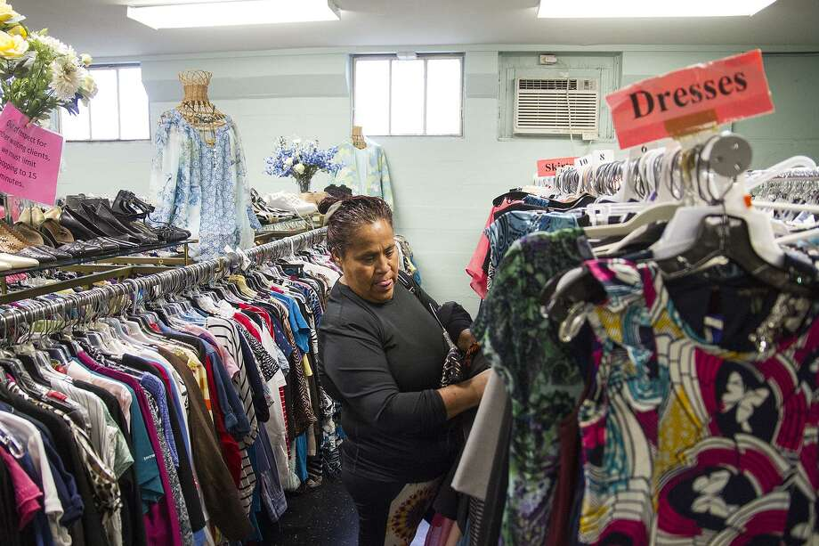 Rosa Munoz Castaneda shops for clothes in the womens pantry at Christian Assistance Ministry Monday, March 26, 2018. The pantry provides two complete outfits, shoes, purses, belts, underware, seasonal items like jackets and hygiene kits for the homeless. Photo: Photos By Alma E. Hernandez /For The San Antonio Express News