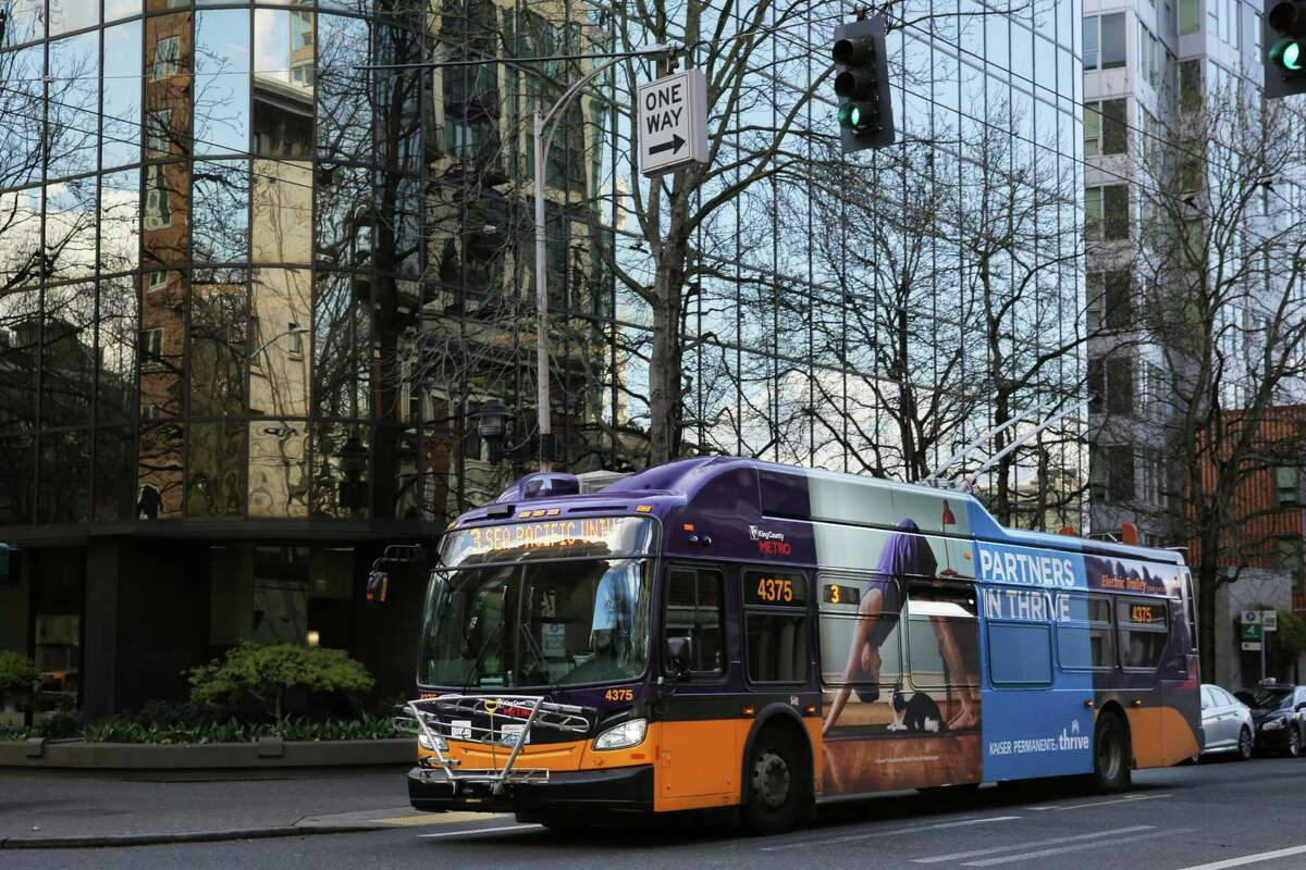 A King County Metro bus drives through Belltown, Monday, April 2, 2018.