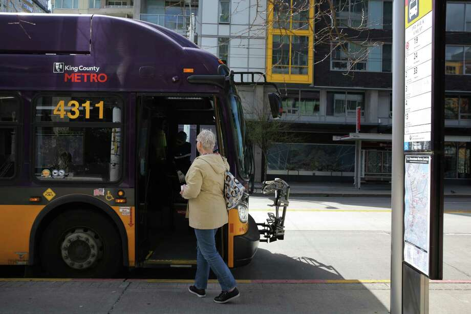A King County Metro bus makes a stop on 3rd Avenue, Monday, April 2, 2018. Photo: GENNA MARTIN, SEATTLEPI.COM / SEATTLEPI.COM