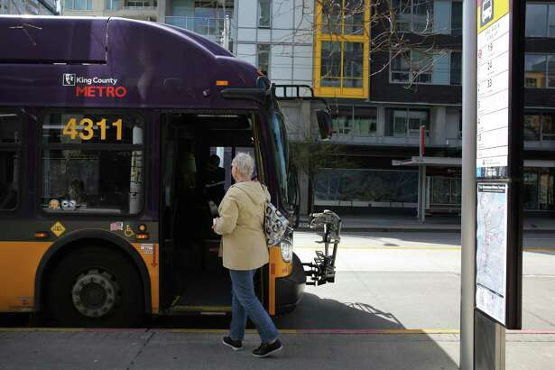 A King County Metro bus makes a stop on 3rd Avenue, Monday, April 2, 2018.