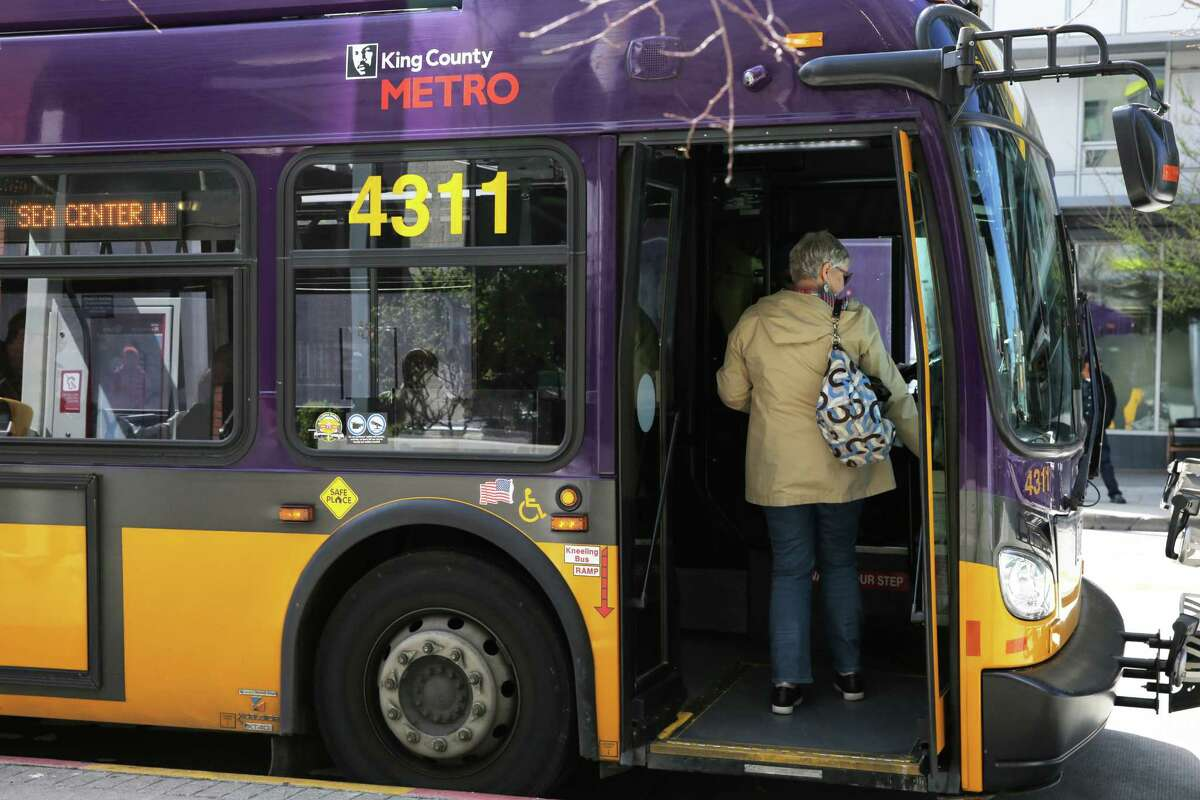 A King County Metro bus makes a stop on 3rd Avenue, Monday, April 2, 2018. An estimated 2,500 buses travel down 3rd each day.  Buses and bicyclists will have the busy arterial to themselves, from 6 a.m. to 7 p.m., through downtown Seattle.  Private vehicles will be banned.