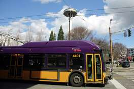 A King County Metro bus drives down 3rd Avenue in Belltown, Monday, April 2, 2018.